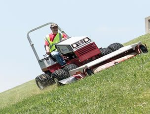 riding lawn mower on a steep incline