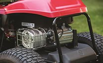 """The best 30"""" riding lawn mower's OHV engine positioned at the back of the Troy-Bilt mower"""