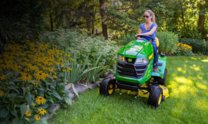 Woman on John Deere D125